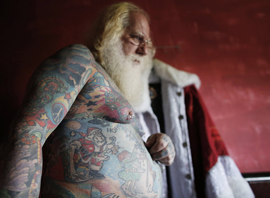 Vitor Martins displays one of his Christmas tattoos inside his house near Sao Paulo
